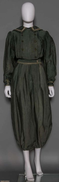 LADY'S BICYCLE SUIT, 1890 Pale green wool, white piped sailor collar, cuffs & waist
