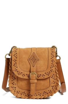 Whipstitched detailing and laser-cut perforations bring a Western vibe to  this crossbody bag in 13bfa1f763af7