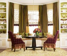 bay windows with draperies and window seat