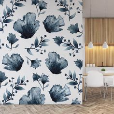 Dark blue coloured watercolor flower decals on a white kitchen wall.