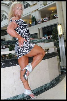Female Bodybuilder Gillian Kovack posing her muscular calves for HDPhysiques!