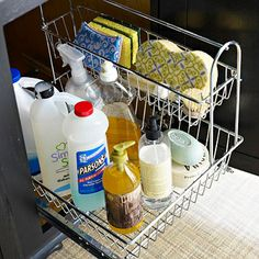 Designate 30 minutes to organize the jumbled mess of dish cleaning supplies under the sink. Outfit the space with a two-tier wire rollout rack. Give your back a break by storing small items, such as sponges and scrubbing brushes, on the top level and tall items, such as dish soap and hand soap, on the bottom.