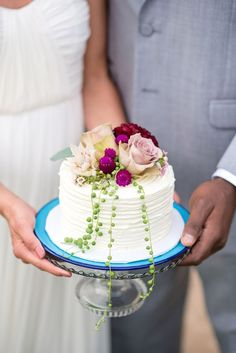 Featuring combed icing, this tiny cake was topped with roses, dahlias, 'Blushing Bride' proteas, scabiosas, and string of pearls | Photo by Kasey and Ben Photography | Cake by Cake and Cookie | Floral design by Petal Pusher