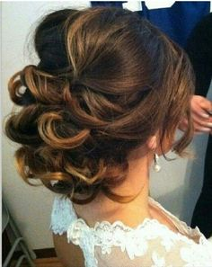 A stunning loose updo on highlighted brunette hair | thebeautyspotqld.com.au