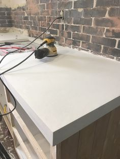 Here's all the details you need to know about installing your own white concrete countertops. DIY white concrete countertops are easier than ever. Concrete Countertop Forms, Cost Of Countertops, Concrete Kitchen, Concrete Table, Stained Concrete, Concrete Floors, Concrete Projects, Concrete Design, Cocina Diy