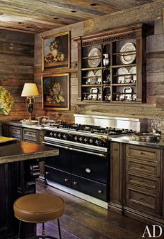 A rustic wood kitchen in a Tennessee mountain home designed by Suzanne Kasler.