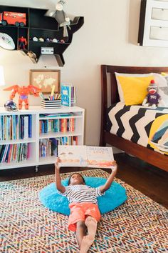 The rug is World Market , as is the USA shelf (no longer available). The bookshelf is IKEA.