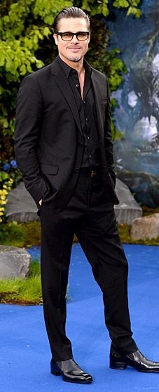 Brad Pitt is all man in a two-button Viaggio suit by Gucci at a Maleficent Exhibition