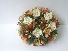 Cream and deep orange roses