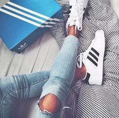 white and black stripe adidas with cutout jeans