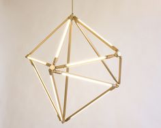 DIY hanging art...take rods, straws, pvc pipes or plumbing pipes and string around to create a non-perfect geometric shape, and voila! #diy