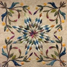 Made at The Quilting Bee Quilt Shop in Fonthill, Ontario by Nellie Zonneveld. Long arm machine quilting by Kelly Corfe. Design by Edyta Sitar of Laundry Basket Quilts