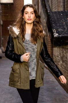 Throw on the Quinn Quilted Anorak Jacket for a crisp fall day. Faux leather quilted sleeves contras the olive anorak body with a faux fur trimmed hood. Style over a sweater dress