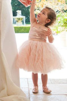 Cute toddler short blush flower girl dress. Spaghetti strap fitted bodice is fit for the infant and toddler. Luxury ruffles flow through short skirt adding dimension for this already awesome flower girl dress.