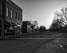 Requiem For A Small Town - The sunsets on an abandoned gravel street in the town of Admire Kansas to set a moody tone to this dying small town