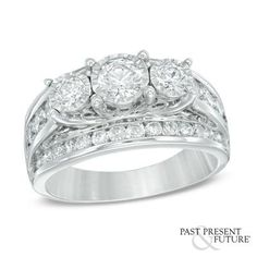 "The phrase ""Past, Present & Future,"" punctuated with two small round diamonds is engraved on the inside of the ring's shank."
