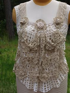 Apron topper made from vintage crochet doilies.