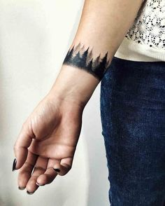 wrist tattoo forest: