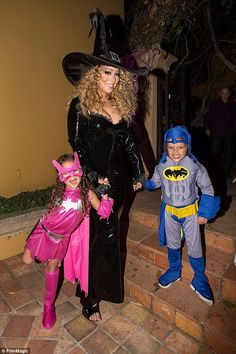 Her little trick-or-treaters! The smiling songbird held hands with her two children as her...