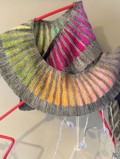 Knitting Pattern for Spectra Scarf by Stephen West - No designer is better with color than Stephen West. This lightweight scarf uses two colors of yarn and short row shaping to create wedges like a color wheel. Great with multi-color yarn! Pictured project by MetalIndigo