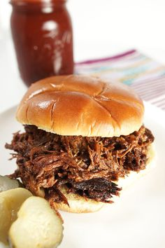 Smoky, tender shredded beef is cooked low and slow in the crock-pot, then tossed in thick, tangy bbq sauce for an easy and delicious weeknight meal. Bbq Beef Crockpot, Crock Pot Slow Cooker, Crock Pot Cooking, Slow Cooker Recipes, Crockpot Recipes, Cooking Recipes, Slow Cooker Bbq Beef, Sirloin Recipes, Fondue Recipes