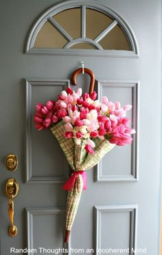 Fill an umbrella with your favorite blooms, then hang from your door for a charming springtime display. Labor Junction / Home Improvement / Doorways / Grey / Spring Projects / Pop of Color / Curb Appeal / www.laborjunction.com