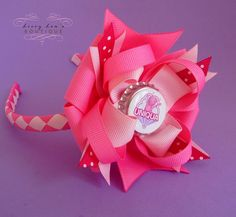 Nick Jr's Backyardigans Uniqua Custom Bottle Cap Boutique Bow in Shades of Pink WITH Matching Woven Headband. $12.00, via Etsy.