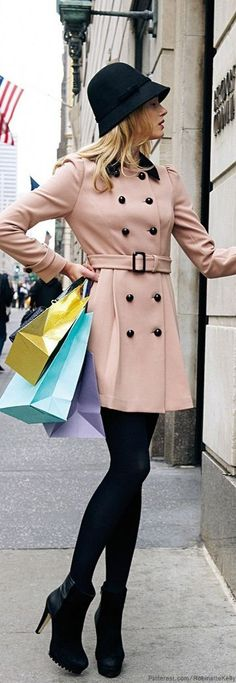 street style for spring - pink trench coat window shopping