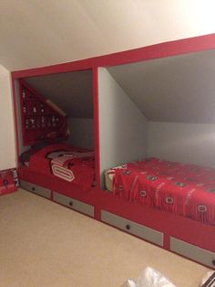 'Bunk' beds built into knee walls with storage beneath.  Great space saver!
