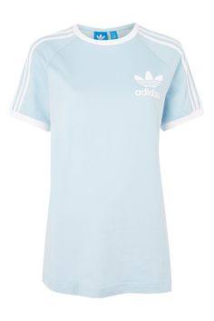 Embrace the sporty look all year round with the iconic tee in a summery blue update. Finished with the trefoil logo to the front, were tucking into high waist jeans for a laidback feel. By Adidas Originals. Adidas Outfit, Adidas Shirt, Fashion Wear, Couture Fashion, Red And White Shirt, Black White, Dolce Gabbana Sneakers, Latest T Shirt, Adidas Fashion