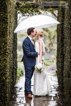#Bride and #Groom in the rain at their Great Fosters #wedding