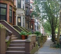 When you live at street level, the stoop and the sidewalk are extensions of your living room – I love that interaction.