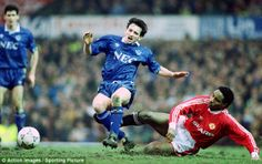 Paul Ince (right) hauls down Everton's Pat Nevin in the Old Trafford clash