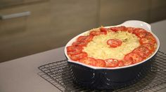 It takes only eight ingredients to re-create this cheesy dish once favored by the late playwright Lillian Hellman. --- no stir macaroni and cheese. Macaroni and cheese casserole with tomatoes