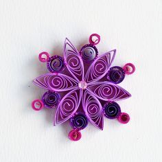 https://flic.kr/p/Bq5Kxk | 6 point small pink and purple quilled snowflake with pink glitter
