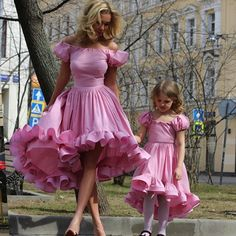 """Mommy and me in full petti-coated dresses."""