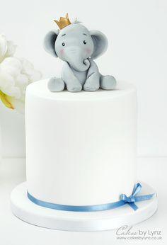 How to make an elephant cake topper FREE video tutorial by Cakes by Lynz Elephant Baby Shower Cake, Elephant Cake Toppers, Elephant Cakes, Baby Shower Cake Toppers, Elephant Birthday Cakes, Elephant Party, Baby Boy Birthday Cake, Baby Boy Cakes, Baby Boy Christening Cake