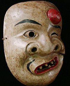 Japanese Kyogen mask. Japan, Painted wood. Kyogen originated in the 14th century, around the same time as the Noh plays. Actors perform the drama wearing masks. The Noh drama centers around themes such as spirituality, love and revenge. In contrast, Kyogen offers comic relief and satirical humor performed between the acts of Noh performances.