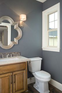 Slate and white, great chrome mirror and fixtures. Great small tile backsplash to incorporate colors.