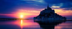 Panoramic view of Mont-Saint-Michel at sunset - Panoramic view of Mont-Saint-Michel at sunset, France.