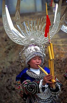 China | A young Miao woman photographed during the Lusheng Festival | © deepchi1 on Flickr    This is a typical headdress for women during the Lusheng Festival.
