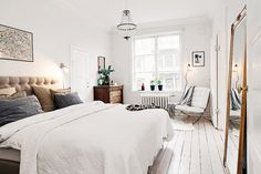 White and neutral bedroom with white floors