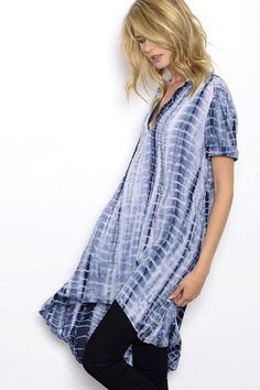 Funky, modern tie-dye print    V-neck adds a touch of flirty charm High-low hem is for trendy profile Style starts and stops with the amazing Tunic T-Shirt
