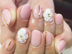 Liked this Amaryllis Nail Chanel white flower nail art design on pink with gold detailing.