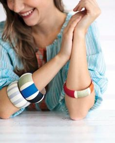 DIY striped bangles -- Use a basic decoupage process and add bright tissue-paper stripes after whitewashing inexpensive wooden bracelets