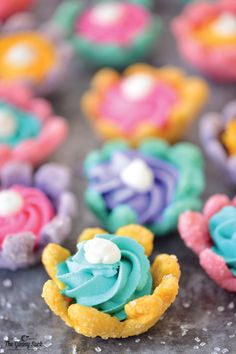 These adorable Bloomin' Flower Cookies are perfect for a summer birthday party! Simply slice colored sugar dough into flower shapes and bake them on an upside down mini muffin tin. Fill the cookie cups up with a dollop of brightly colored icing--these sweet treats couldn't be cuter!