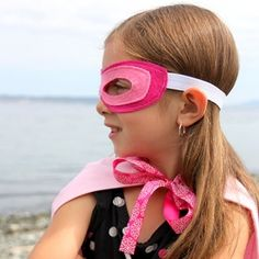Turn your kid into a superhero in only 10 minutes with this quick and easy DIY costume. Includes printable for 3 different mask designs.