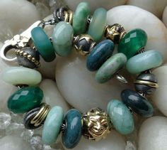 Very pretty greens. Soothing stones. I do not know who created this bracelet. Pinned from KM