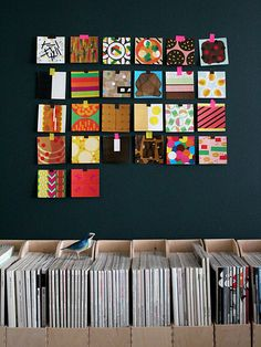 great idea...fill old CD cases with pretty papers...hang for quick and fab wall art! or use it as a rotating display of LO's artwork.