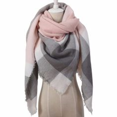 Add this to your scarf collection. A perfect partner for your winter outfit. Featuring its multi color plaid print, tassels hemline. Crafted from cashmere and acrylic material. This shawl is very soft